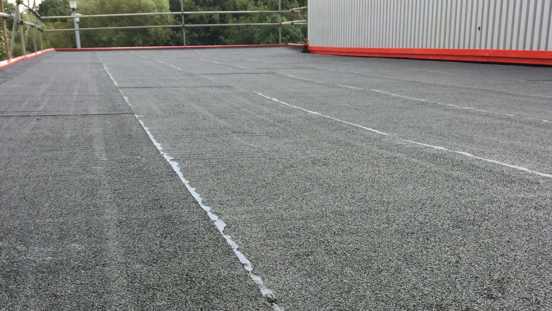 A flat roof that has been installed for a commercial client